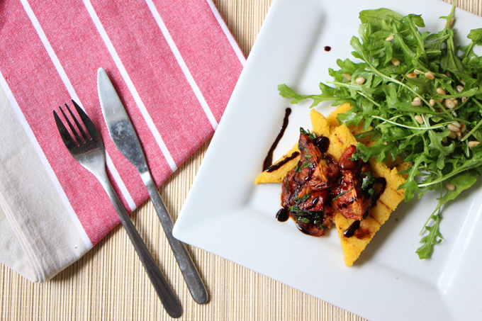 Grilled polenta with oven-roasted tomatoes and a rocket salad